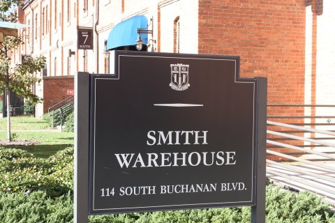 Blue sign in front of red brick building