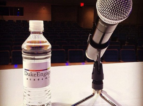 A DukeEngage water bottle and a microphone