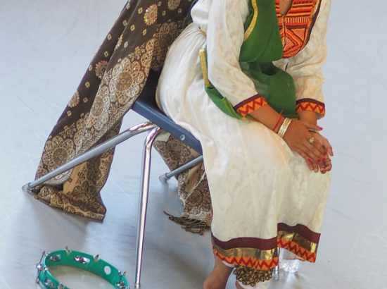 Woman seated in tradtional Indian dancewear