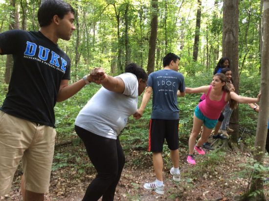 guiDEs participate in low ropes course for the fall retreat.