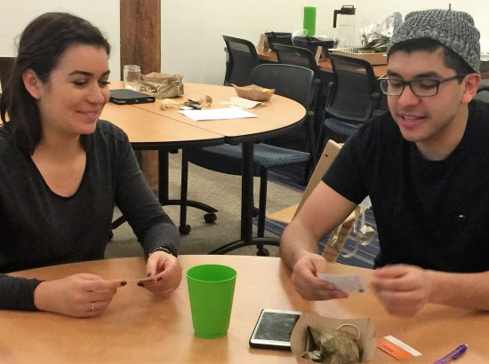 Aitana (Orange County ''15) and Juan (Colombia '15) contribute to DukeEngage's brainstorm principles of partnership (and try some of the best tamales in the Triangle).