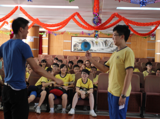 Students perform with Chinese Yo-Yo in front of audience of other students