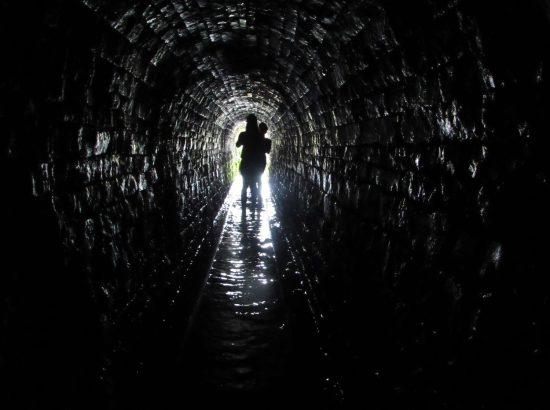 figure walking though tunnel