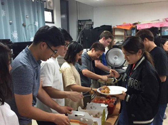 Group of people serving and receiving food
