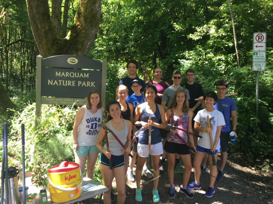 Students smiling next to the sign for the Marquam Nature Park