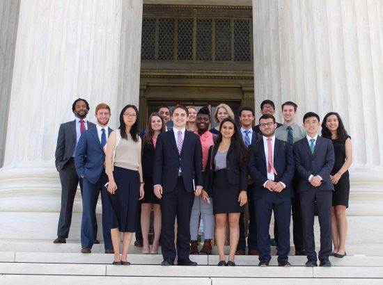 Students standing in front of supreme court building
