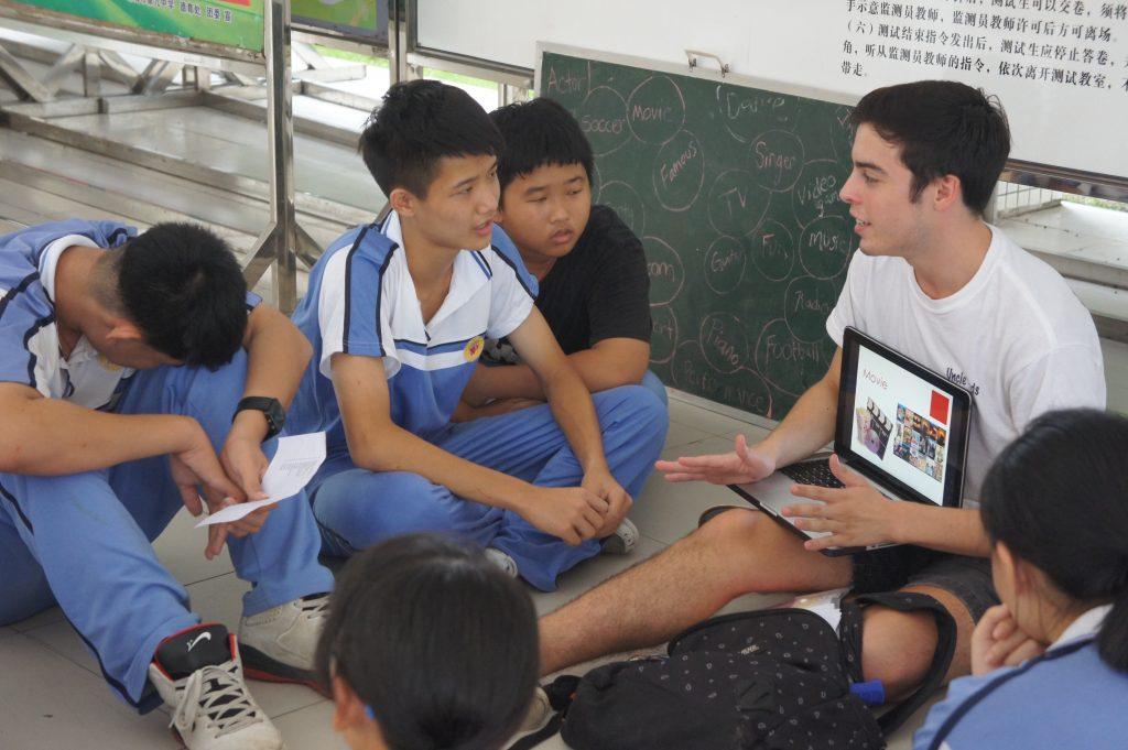 DukeEngage student explaining something to a group of younger students