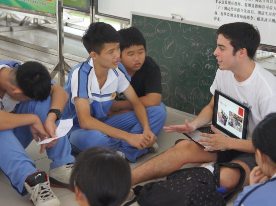 DukeEngage student explaining something to a group of younger students