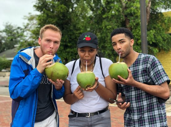 Three students drinking coconut mik