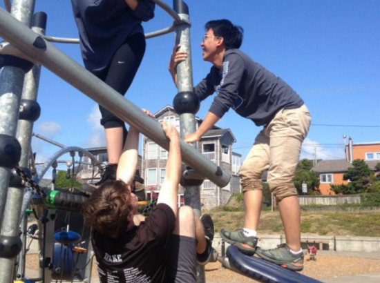 Students climb on an outdoor playground