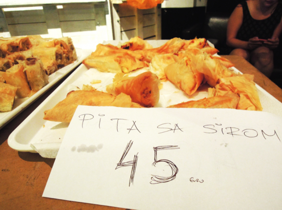 "Tray of food with sign reading ""Pita Se Sirom - 45 Euro"""
