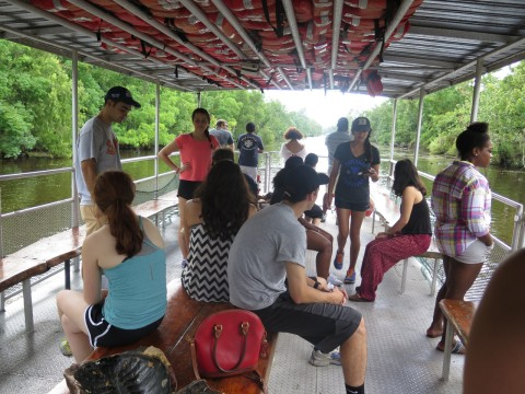 Students seated on a riverboat.