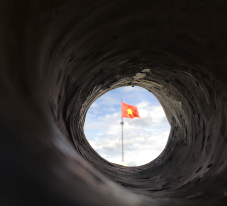 Tunnel with a flag at the end of it
