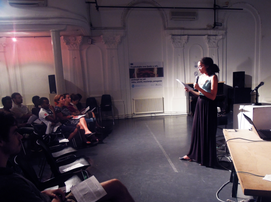 Woman performs in front of an audience