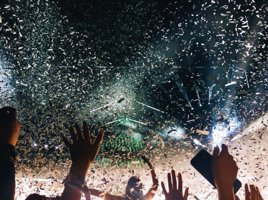 Hands at festival with confetti