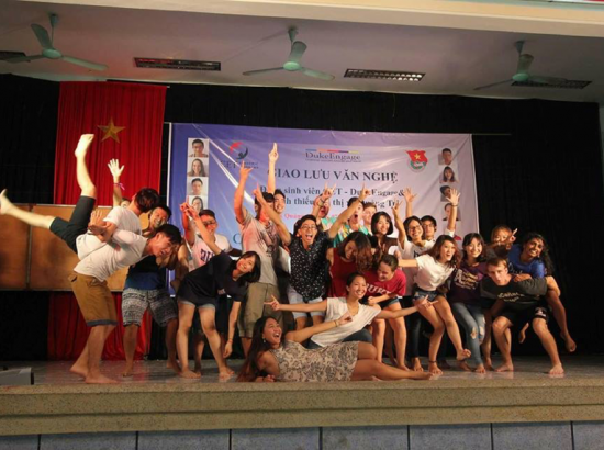 Group of students posing on a stage