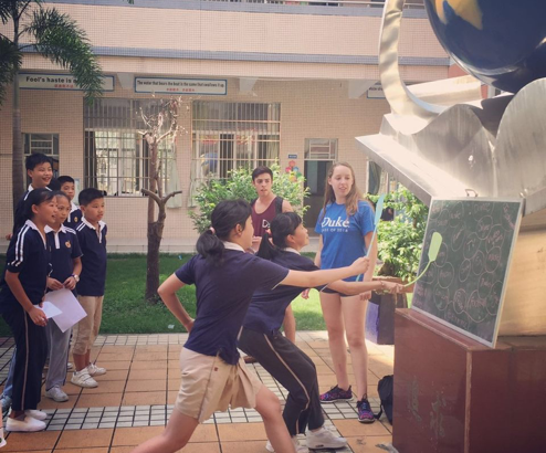 Students play a game outside