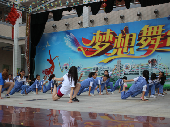 Students stretch on performance stage