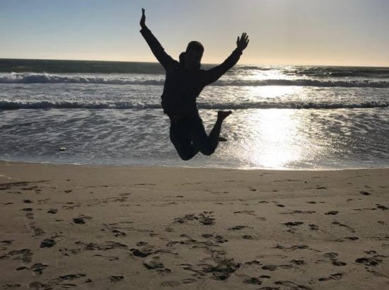 A person jumping at the beach