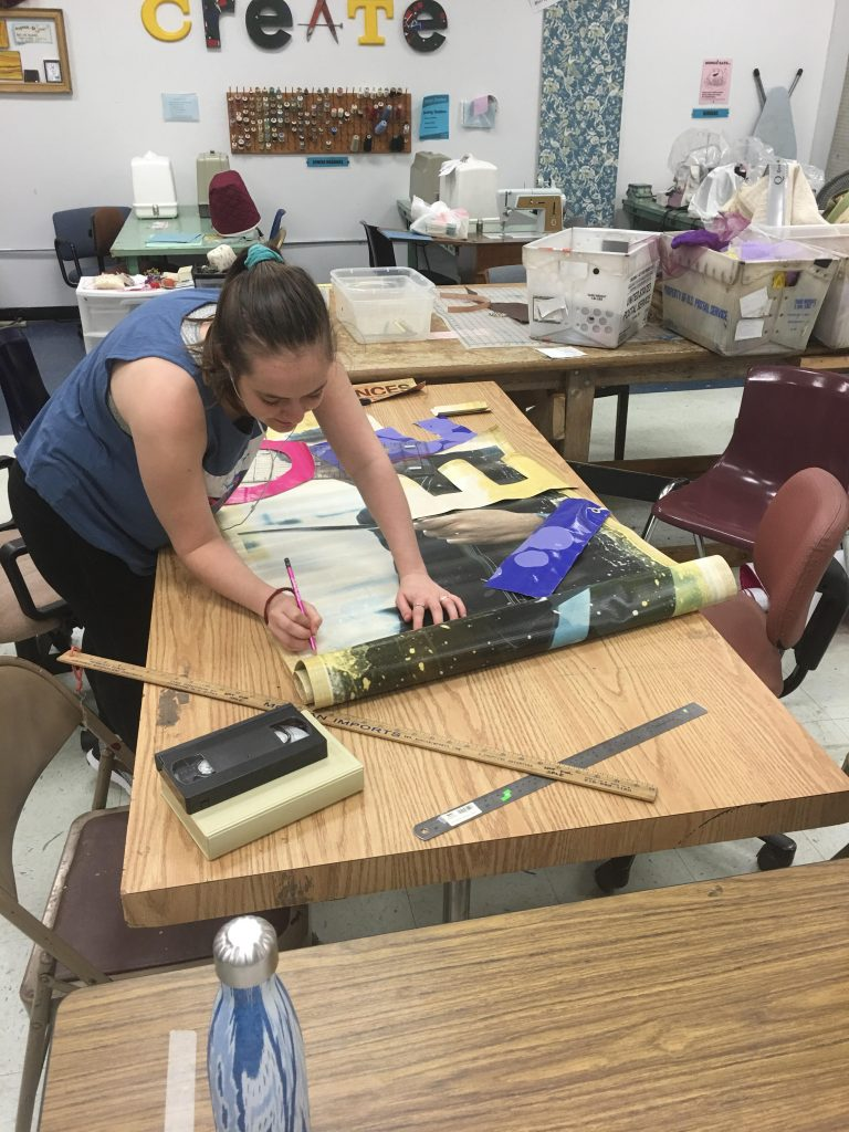 Young woman working on crafting table