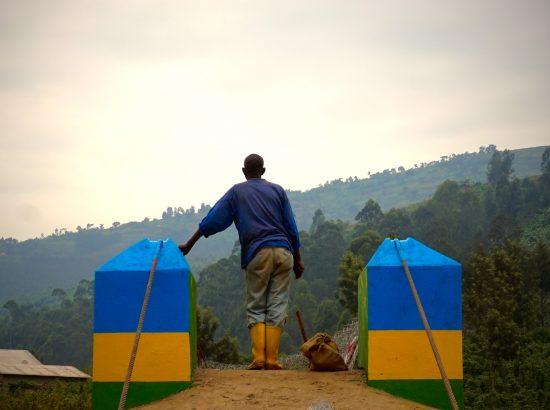 a man stands overlooking a mountainous landscape
