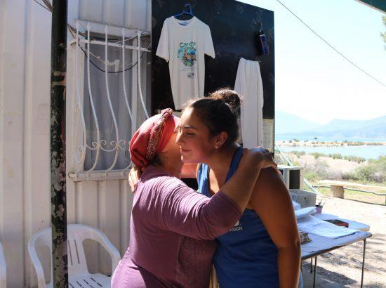student hugging Turkish host mother