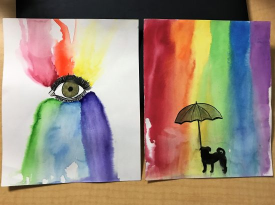 Two rainbow themed paintings