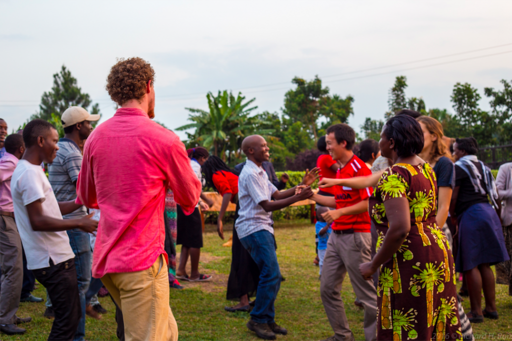 DukeEngage students and members of the community in Uganda join hands and celebrate