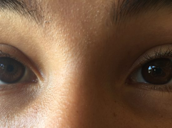 close-up photo of a young woman's eyes