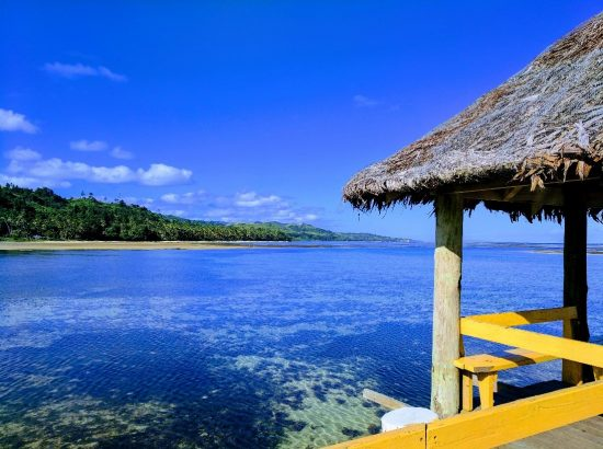 open air hut overlooking blue lagoon
