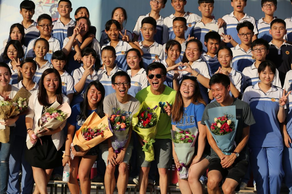 Many students stand together at 9th grade graduation in China