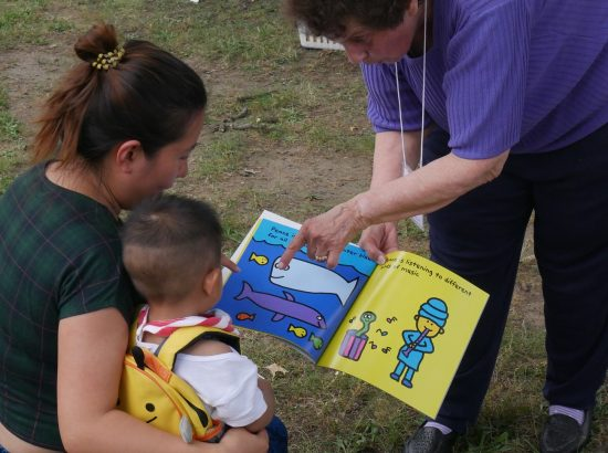 Adults reading to a child