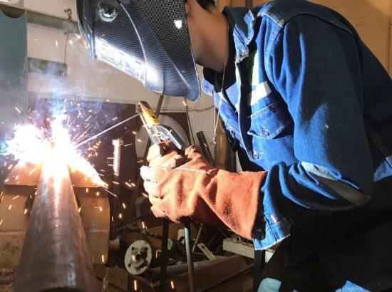 Man stick welding
