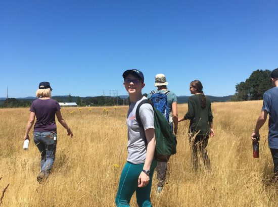 DukeEngage students walking through a field in Portland