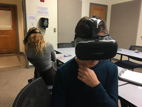 young people wearing virtual reality viewing equipment in a classroom
