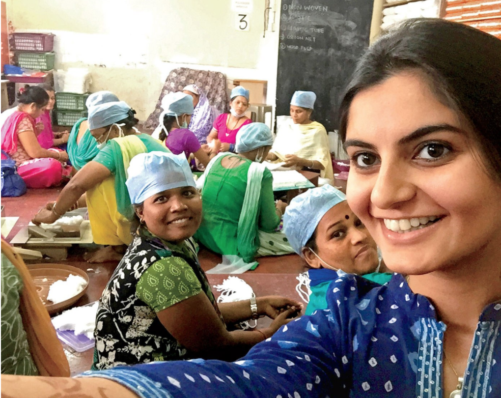 Girl taking selfie with women in classroom in India
