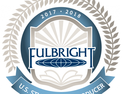 fancy blue and gray circular logo with word Fulbright in center