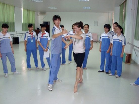 teacher teaching students how to dance