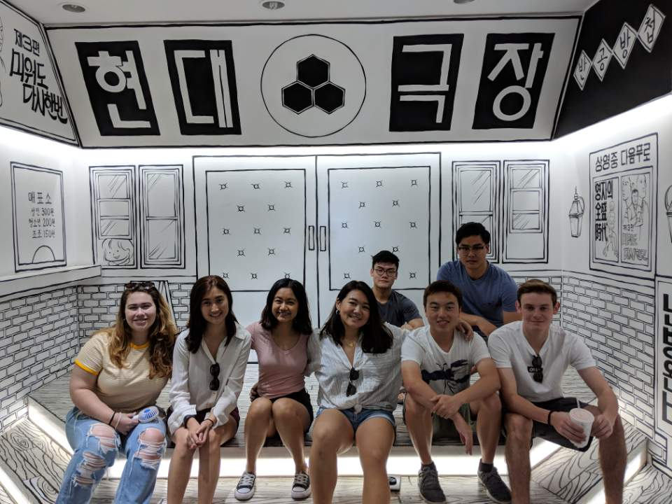 people posing in a black and white cartoony background