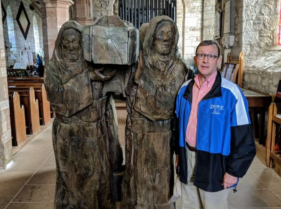 "Sam Miglarese with The Journey sculpture, by Fenwick Lawson. You can also find a bronze sculpture of St. Cuthbert's ""Journey"" in Millennium Park, Durham, UK."