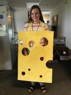 person dressed as Swiss cheese