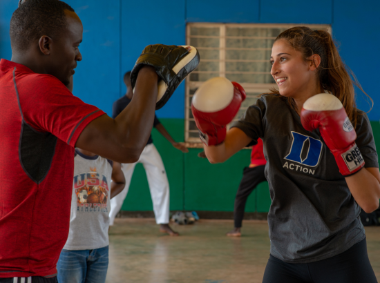 Man and woman participating in boxing exercise