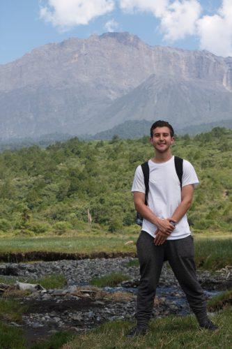Male student smiles in Tanzania