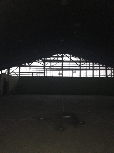 a darkly lit, large exercise space