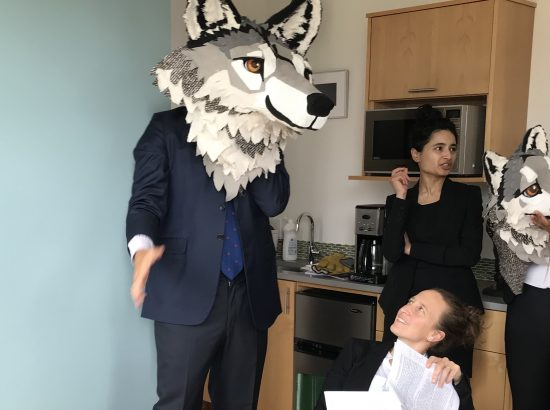 Crag staff posing with wolf puppets for photo shoot