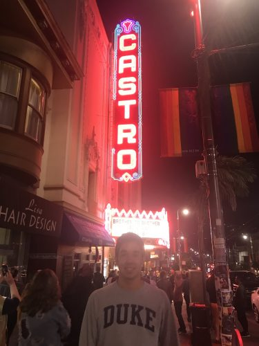 Duke student standing in front of historic Castro Theater