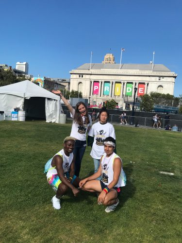 Four students posing at civic center in San Francisco Pride