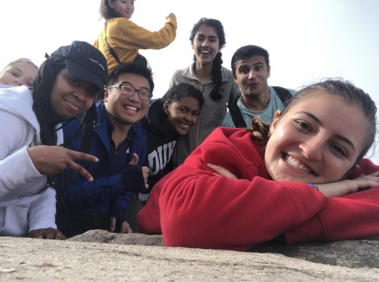 Group of students on top of mountain