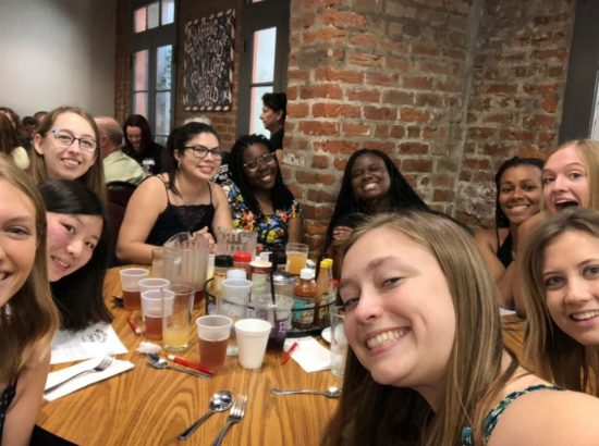 members of the New Orleans cohort eating dinner