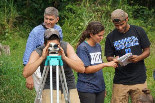 David Schaad and 3 DukeEngage Students out in the field
